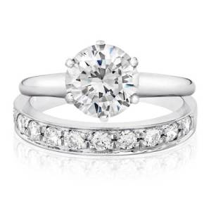 Two Plain Wedding Rings with Solitaire Detail